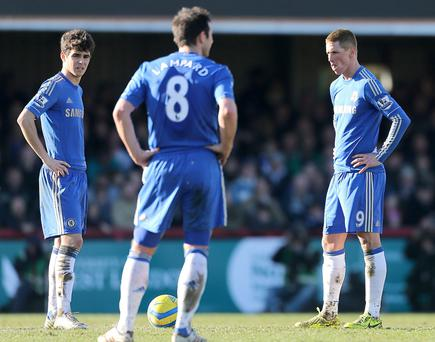 Chelsea's Emboaba Oscar (left), Fernando Torres (right) and Frank Lampard stand dejected after conceding their first goal of the game during the FA Cup, Fourth Round match at Griffin Park, Brentford. PRESS ASSOCIATION Photo. Picture date: Sunday January 27, 2013. See PA story SOCCER Brentford. Photo credit should read: Nick Potts/PA Wire. RESTRICTIONS: Editorial use only. Maximum 45 images during a match. No video emulation or promotion as 'live'. No use in games, competitions, merchandise, betting or single club/player services. No use with unofficial audio, video, data, fixtures or club/league logos.