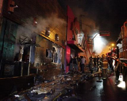 Firefighters work to douse a fire at the Kiss Club in Santa Maria city, Rio Grande do Sul state, Brazil, Sunday, Jan. 27, 2013. Firefighters say that the death toll from a fire that swept through a crowded nightclub in southern Brazil has risen to 180. Officials say the fire broke out at the club while a band was performing. At least 200 people were also injured. (AP Photo/Agencia RBS)