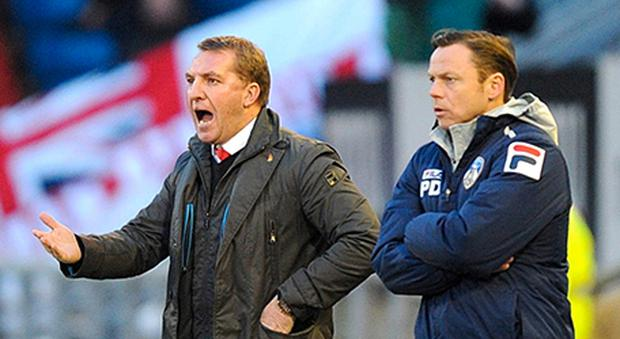 Liverpool manager Brendan Rodgers (left) and Oldham Athletic manager Paul Dickov on the touchline during the FA Cup match yesterday