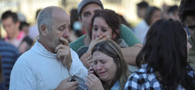 Relatives of the Kiss nightclub victims cry in the southern city of Santa Maria, 187 miles (301 km) west of the state capital of Porto Alegre, in this picture taken by Agencia RBS, January 27, 2013. At least 200 people were killed in the nightclub fire in southern Brazil on Sunday after a band's pyrotechnics show set the building ablaze, and fleeing patrons were unable to find the emergency exits, local officials said. Bodies were still being removed from the Kiss nightclub in the southern city of Santa Maria, Major Gerson da Rosa Ferreira, who was leading rescue efforts at the scene for the military police, told Reuters. Local officials said 180 people were confirmed dead, and Ferreira said the death toll would rise above 200. He said the victims died of asphyxiation, or from being trampled, and that there were possibly as many as 500 people inside the club when the fire broke out at about 2:30 a.m. REUTERS/Germano Roratto/Agencia RBS (BRAZIL - Tags: DISASTER) NO SALES. NO ARCHIVES. BRAZIL OUT. NO COMMERCIAL OR EDITORIAL SALES IN BRAZIL.ATTENTION EDITORS - THIS IMAGE WAS PROVIDED BY A THIRD PARTY. FOR EDITORIAL USE ONLY. NOT FOR SALE FOR MARKETING OR ADVERTISING CAMPAIGNS. THIS PICTURE IS DISTRIBUTED EXACTLY AS RECEIVED BY REUTERS, AS A SERVICE TO CLIENTS