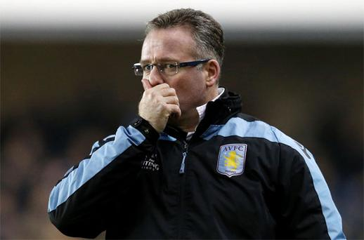 26 January, 2013: Aston Villa manager Paul Lambert reacts during their FA Cup fourth round soccer match against Millwall at The Den. Lambert's Aston Villa side were beaten 2-1