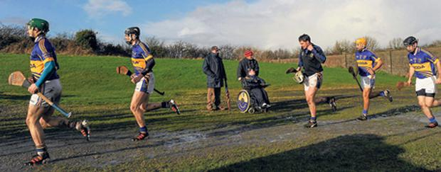 Tipp players make their way past supporters and on to the McDonagh Park pitch in Nenagh