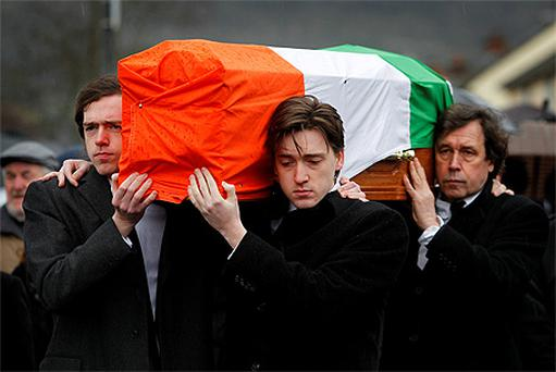 Dolours Price's coffin is carried from her family home Slievegallion Drive in Andersontown West Belfast by her two sons Danny and Oscar at front and her ex partner actor Stephen Rea