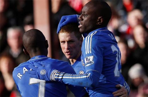 Chelsea's Fernando Torres (C) celebrates his goal against Brentford with team mates Ramires (L) and Demba Ba during their FA Cup fourth round soccer match at Griffin Park. Photo: Reuters