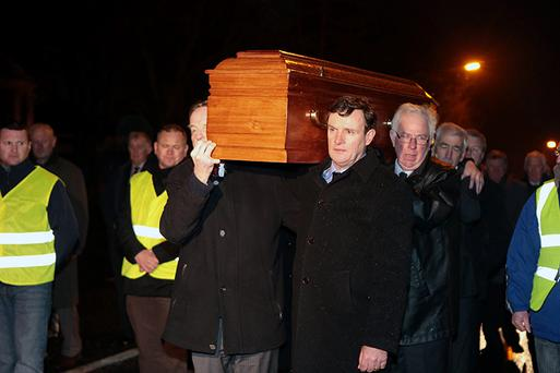 28/1/13 Jimm Keavney and Kevin Moran help carry the coffin at the removal service of Kevin Heffernan at the Church of the St Vincent De Paul, Griffith Avenue, Dublin. Picture:Arthur Carron/Collins