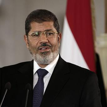 Mohammed Morsi announced a curfew in a televised speech