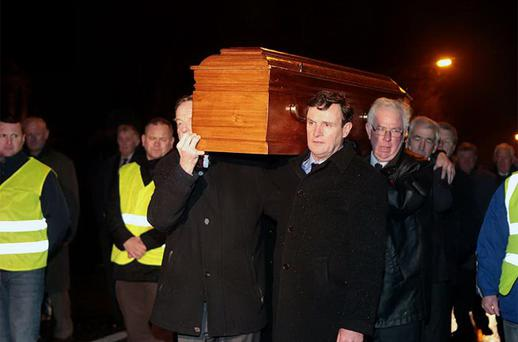 Jimm Keavney and Kevin Moran help carry the coffin at the removal service of Kevin Heffernan at the Church of the St Vincent De Paul, Griffith Avenue, Dublin. Photo: Collins