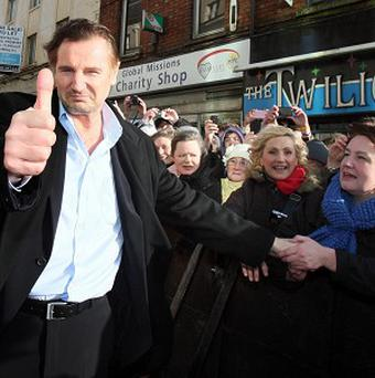 Hollywood actor Liam Neeson is welcomed by well-wishers to Ballymena town centre, where he was granted Freedom of the Borough