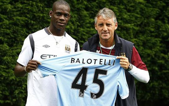 Mario Balotelli signed a five-year deal in August 2010 and his City career ever since has been a colourful one to say the least. The early signs weren't promising - he barely managed a smile for the customary new shirt photo op. Photo: AP