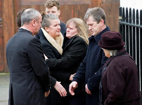 Wednesday 30 January 2013. Funeral of Eamon de Buitléar in St. Patrick's Parish church, Kilquade Co. Wicklow.Family greting friends at church gate.