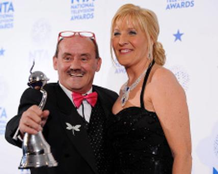 National Television Awards 2013 - Press Room - London...Brendan O'Carroll and his wife Jennifer Gibney with the Best Situation Comedy Award for Mrs Brown's Boys, in the press room at the 2013 National Television Awards at the O2 Arena, London....E
