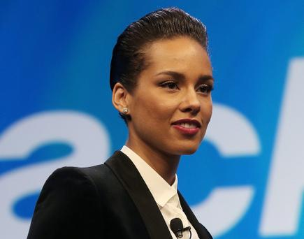 NEW YORK, NY - JANUARY 30: BlackBerry Global Creative Director Alicia Keys holds a new BlackBerry at the BlackBerry 10 launch event at Pier 36 in Manhattan on January 30, 2013 in New York City. The new smartphone and mobile operating system is being launched simultaneously in six cities. (Photo by Mario Tama/Getty Images)