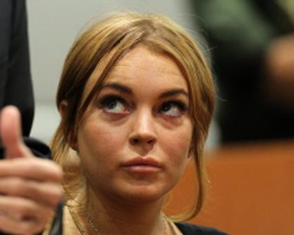 LOS ANGELES, CA - JANUARY 30: Troubled actress Lindsay Lohan appears in court for a pretrial hearing before Judge Stephanie Sautner at the Airport Branch Courthouse of Los Angeles Superior Court on January 30, 2013 in Los Angeles, California. Lohan is charged with three misdemeanor counts involving a car crash - willfully resisting, obstructing or delaying an officer, providing false information to an officer and reckless driving. She is also accused of violating her probation in a misdemeanor jewelry theft case. (Photo by David McNew/Getty Images)