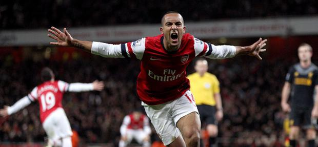 Arsenal's Theo Walcott celebrates scoring his teams second goal of the game during the Barclays Premier League match at the Emirates Stadium, London. PRESS ASSOCIATION Photo. Picture date: Wednesday January 30, 2013. See PA story SOCCER Arsenal. Photo credit should read: Nick Potts/PA Wire. RESTRICTIONS: Editorial use only. Maximum 45 images during a match. No video emulation or promotion as 'live'. No use in games, competitions, merchandise, betting or single club/player services. No use with unofficial audio, video, data, fixtures or club/league logos.