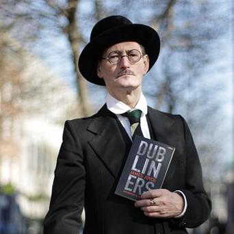 Finnegans Wake, a novel by James Joyce, shown posed by an actor, has proved to be a hit in China