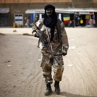 Chadian troops patrol the streets of Gao, northern Mali (AP)