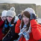 Lindsay Klassen, Melissa Klassen, Christie Hodge and Maddi Brick hang on to their hats at the famous Cliffs of Moher