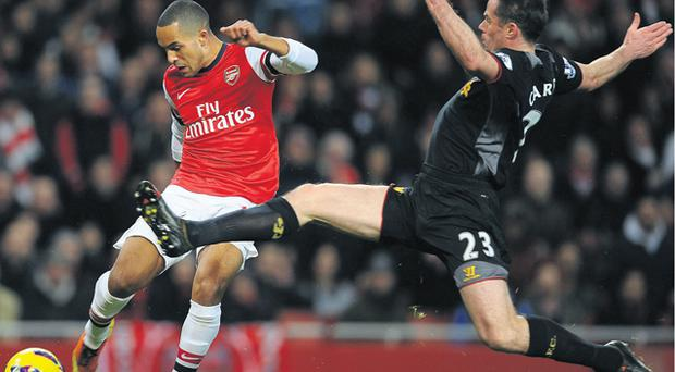 Jamie Carragher fails to prevent Theo Walcott from scoring Arsenal's equalising goal