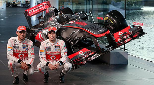 McLaren driver's Sergio Perez (right) and Jenson Button during the launch of the new car