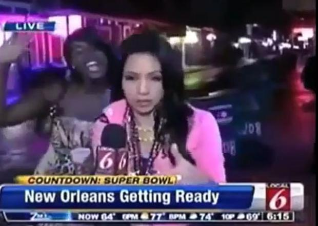 The woman attempted to interrupt the live broadcast.