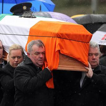 The coffin being carried during the state funeral of Detective Garda Adrian Donohoe