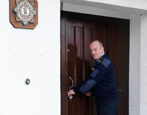 Garda Pat Murphy, locks the doors for the final time at Kill station, Kildare, on the day the station closed its doors, as the closure of 95 garda stations will be carried out to meet today's policing needs, and not because of the tightening of public purse strings, it was claimed. PRESS ASSOCIATION Photo. Picture date: Thursday January 31, 2013. Justice Minister Alan Shatter defended his decision, which he claimed will improve the quality of policing in communities and not deprive them of resources.The minister said garda stations manned for a couple of hours a day do not act as a deterrent to burglars, adding that the spike in crime in 2011 was before any closures. See PA story POLICE Stations Ireland. Photo credit should read: Niall Carson/PA Wire