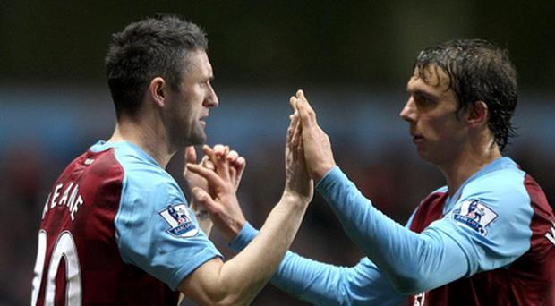 Soccer - Barclays Premier League - Aston Villa v Everton - Villa Park...Aston Villa's Robbie Keane (left) replaces team mate Stephen Warnock during the Barclays Premier League match at Villa Park, Birmingham. PRESS ASSOCIATION Photo. Picture date: Saturday January 14, 2012. See PA story SOCCER Villa. Photo credit should read: Nick Potts/PA Wire. RESTRICTIONS: Editorial use only. Maximum 45 images during a match. No video emulation or promotion as 'live'. No use in games, competitions, merchandise, betting or single club/player services. No use with unofficial audio, video, data, fixtures or club/league logos....S