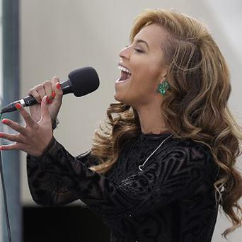 Beyonce has admitted she lip-synched the national anthem at the ceremonial swearing-in for President Barack Obama (AP)