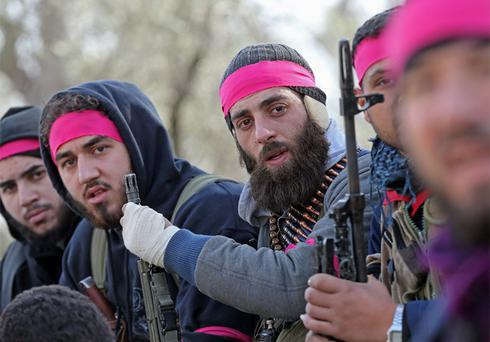 Free Syrian Army fighters sit in a truck in Haresta neighbourhood of Damascus. Photo: Reuters