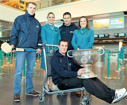 Aer Lingus staff Grainne Kelly and Orla Kelly with Lar Corbett, left, Dessie Farrell and Brian McGuigan