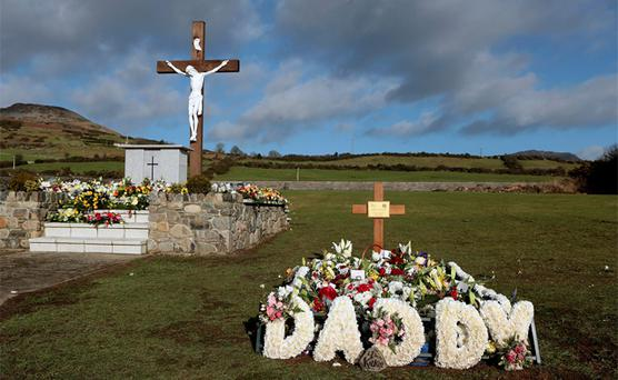 Floral tributes on the grave of Garda Detective Adrian Donohoe in Lordship, near Dundalk