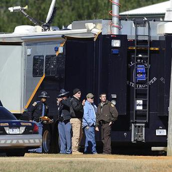 Law officers beside command post at the Dale County hostage scene in Midland City, Alabama (AP/Montgomery Advertiser, Mickey Welsh)