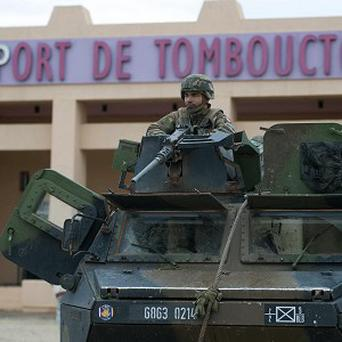 A French soldier guards the Timbuktu airport, in northern Mali (AP/Arnaud Roine; EMA-ECPAD)