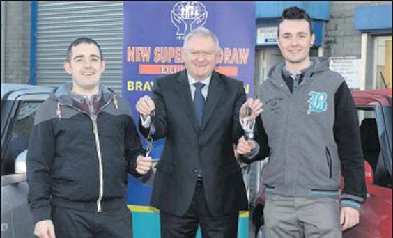 Jordan Forde and Dean Cox are lucky December winners of the Bray Dredit Union monthly car draw, with Michael Doyle of Michael Doyle cars.