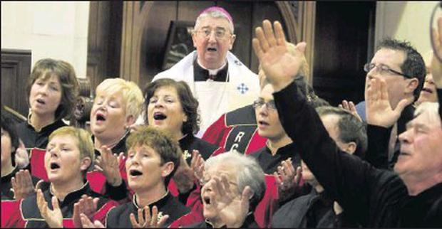 ■ Archbishop Diarmuid Martin with the Revival gospel choir in St. Saviours, Arklow at the Christian Unity Service.