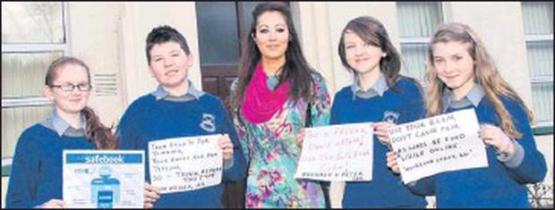 Students Aoife O'Driscoll, Josh Mullen, Sarah Deed & Muireann Lynch with teacher, Carol Warren in Bishop McEgan College, Macroom, have been actively engaging with the 'SafeBook' campaign which was recently launched by Cork company 'Fuzion PR'. This... Credit: Photo by John Delea