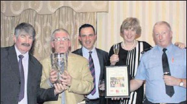 Tom MacGrath, Blarney Person of The Year 2012, pictured with Blarney Community Council Chairman Kevin Conway, Blarney Chamber of Commerce Chairman Damian Boylan, Kate Durrant and Blarney Sergeant Pat Murphy. Photo: Kay Dennehy