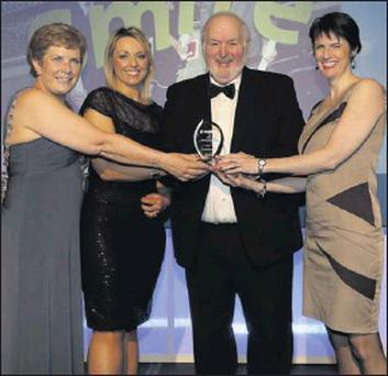 At the national Local Authority Members Association awards this week chairman Cllr Hugh McElvaney presents the 'Best Eco-Friendly Initiative' award to Cork county mayor Cllr Barbara Murray and Macroom SMILE Resource Exchange leaders Michelle Green and...
