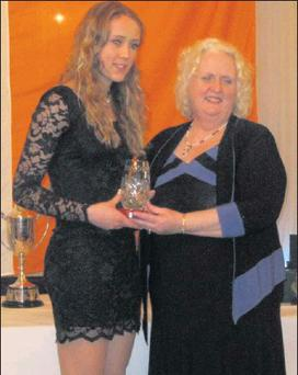 Boyne AC's Amy McTeggart is presented with her Leinster Star Award for the leading female athlete in County Louth at the annual presentation evening in Carlow.
