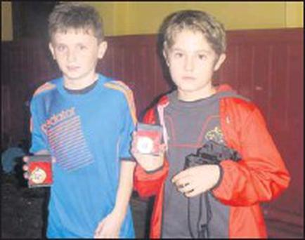 Euan Canniffe and Eoghan Brennan who won club awards at Boyne ACs Christmas party.