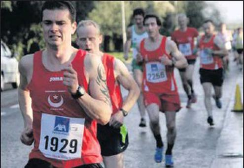 Paddy Moore digs deep for Drogheda & District during the Raheny road race.