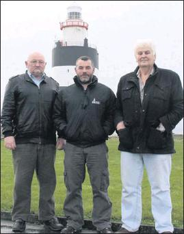 Lighthouse keepers Jimmy Cullen (left) and Tux Tweedy (right) with Liam Colfer of Hook Heritage at Hook Lighthouse last week.
