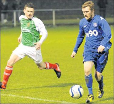 Stephen Richardson of Glebe North teases the Wayside Celtic defence during last Friday night's Leinster Senior League game at Market Green. -Match report on Page 72