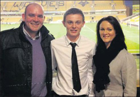 Conor Levingstone who has been signed up by Wolverhampton Wanderers with his parents James and Caroline.