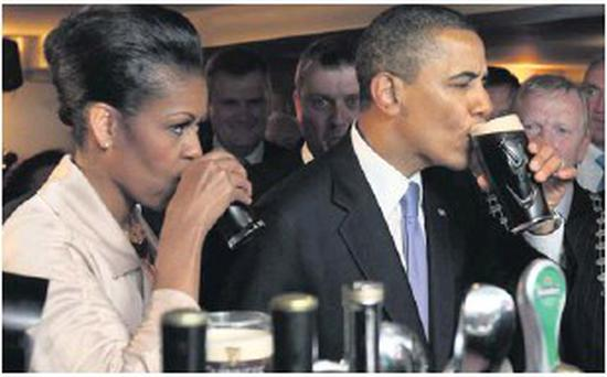 Michelle and Barack Obama having a sup of the black stuff in Moneygall during their visit in 2011. Might this year see them having a pint in New Ross?