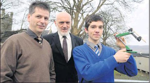 Robert Leask of Presentation Secondary School, Milltown, winner of the first prize in the Senior Individual Technology category for his project 'Ellipse Compass' with his teacher Denis Maguire and Milltown Presentation Secondary School principal Cormac... Credit: Photo by Michelle Cooper Galvin
