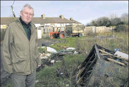 Cllr. Tim O'Leary bringing the state of illegal dumping at the rear of houses on O'Connell's Avenue to the attention of Listowel Town Council. Credit: Photo by John Reidy