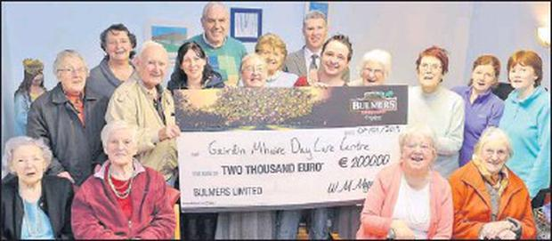 Gairdin Mhuire accepts a €2,000 donation thanks to Daniel Hickey. Front, from left: Bridget White, Nora Fitzgerald, Joan Devane and Adi Nash. Back, Mary Griffin, Elsie Moore, Michael O'Shea, Mary O'Donnell, Joe Curran, Sr deSales, Nora Curran, Sean...