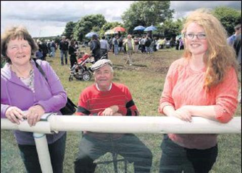 Mick Fehilly, Dunmanway pictured with Duagh mom and daughter, Geraldine and Mairéad McNamara at the annual Castleisland Races at Powell's Road in June 2012. The committee has invited charitable organisations to apply for the proceeds of the 2013 meeting. Credit: Photo by John Reidy
