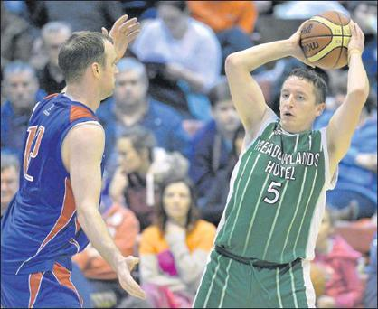Robert O'Sullivan, St Brendan's, in action against Tim O'Halloran, Blue Demons during Basketball Ireland Men's Senior National Cup Semi-Final in Neptune Stadium at the weekend Photo: Brendan Moran / Sportsfile